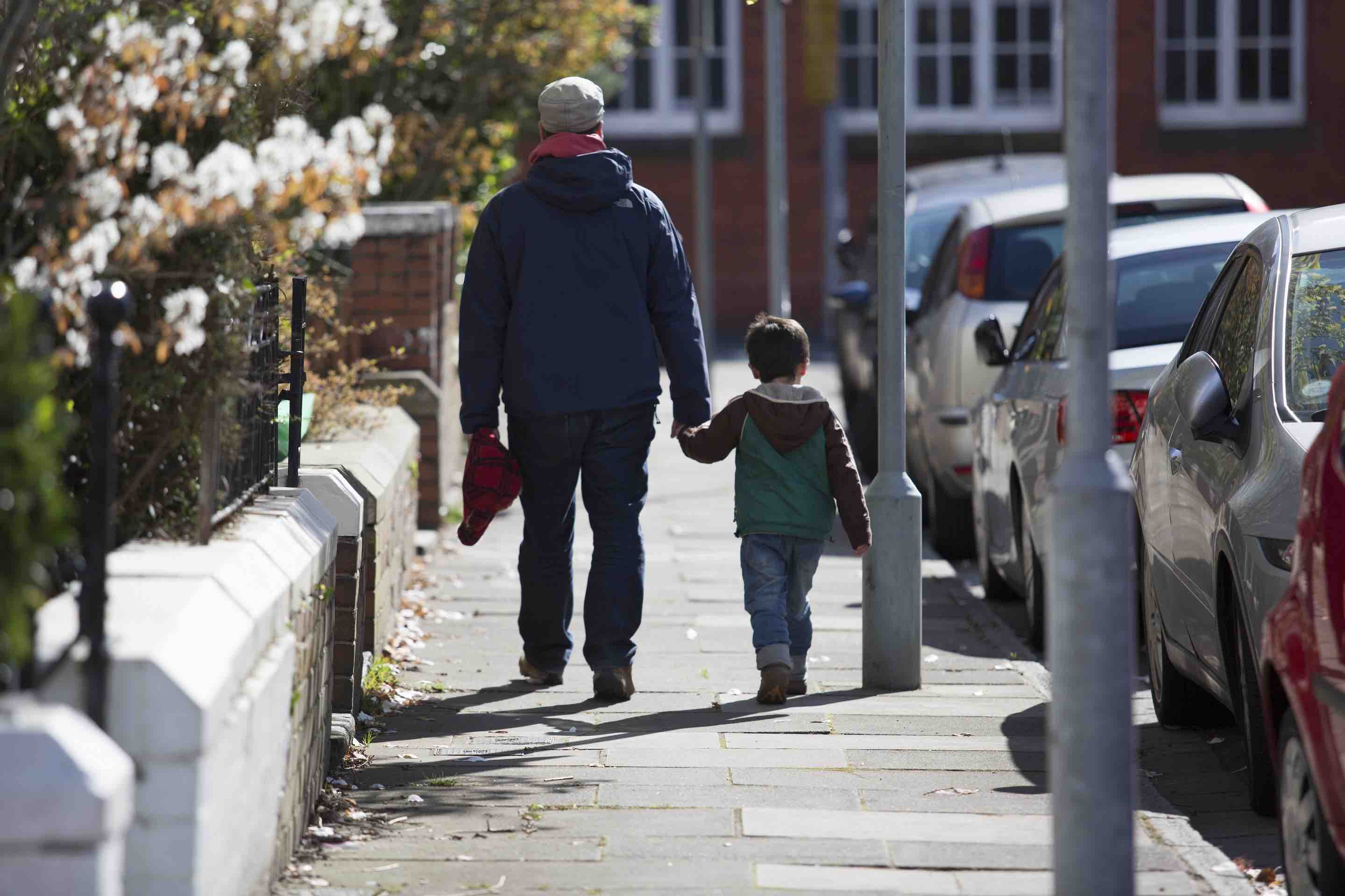 man and child walking together